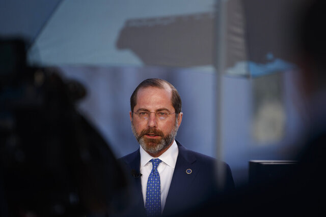 Health and Human Services Secretary Alex Azar speaks during a television interview outside the White House in Washington, Monday, March, 9, 2020. (AP Photo/Carolyn Kaster)