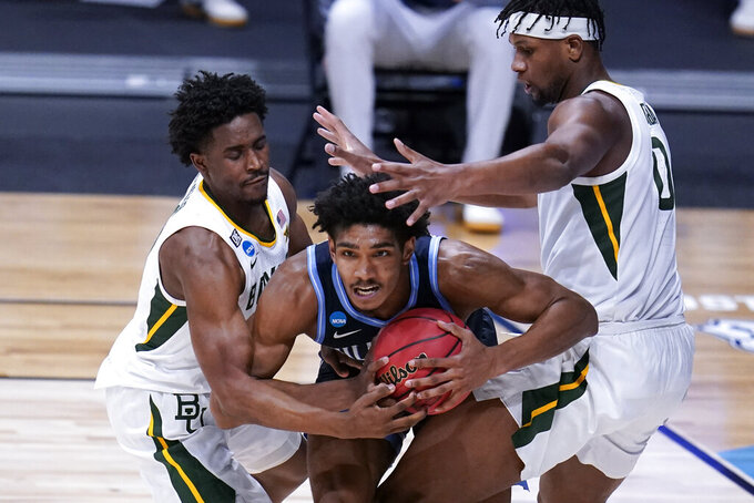 Villanova forward Jermaine Samuels, center, tries to pass from defensive pressure from Baylor guard Adam Flagler, left, and Baylor forward Flo Thamba, right, in the second half of a Sweet 16 game in the NCAA men's college basketball tournament at Hinkle Fieldhouse in Indianapolis, Saturday, March 27, 2021. (AP Photo/Michael Conroy)
