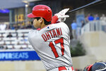 Los Angeles Angels' pitcher Shohei Ohtani drives in a run on a single off Minnesota Twins pitcher Kyle Gibson in the sixth inning of a baseball game Tuesday, May 14, 2019, in Minneapolis. (AP Photo/Jim Mone)