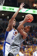 Wake Forest's Andrien White (13) shoots as Pittsburgh's Terrell Brown (21) defends during the first half of an NCAA college basketball game, Saturday, Jan. 4, 2020, in Pittsburgh. (AP Photo/Keith Srakocic)