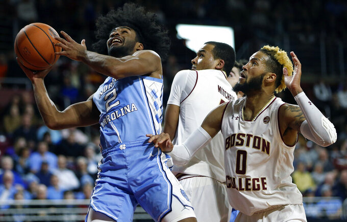 North Carolina's Coby White (2) shoots against Boston College's Ky Bowman (0) during the second half of an NCAA college basketball game in Boston, Tuesday, March 5, 2019. (AP Photo/Michael Dwyer)