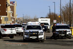 Police and paramedics are seen outside a Walmart store in Broomfield, Colo. on Tuesday, Feb. 18, 2020. A man and woman exchanged gunfire inside the suburban Denver Walmart, panicking shoppers and triggering a swarming police response, police said. (Hyoung Chang/The Denver Post via AP)