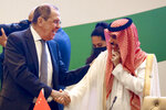 In this handout photo released by Russian Foreign Ministry Press Service, Russian Foreign Minister Sergey Lavrov, left, greets Foreign Minister of the Kingdom of Saudi Arabia, Faisal bin Farhan Al Saud prior to a Central and South Asia 2021 conference in Tashkent, Uzbekistan, Friday, July 16, 2021. (Russian Foreign Ministry Press Service via AP)