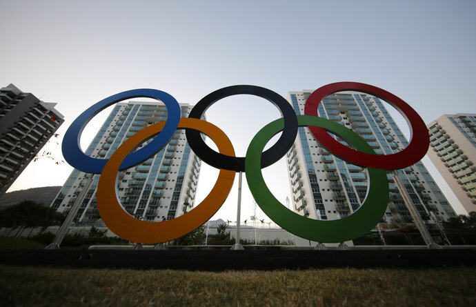 FILE - In this July 23, 2016, file photo, a representation of the Olympic rings are displayed in the Olympic Village in Rio de Janeiro, Brazil. The U.S. Olympic and Paralympic Committee will add athletes to its board and enhance its oversight of individual sports organizations. It's part of a package of reforms stemming from the Larry Nassar sex-abuse scandal. The reforms were approved Thursday, Nov. 8, 2019 and go into effect in January. (AP Photo/Leo Correa, File)