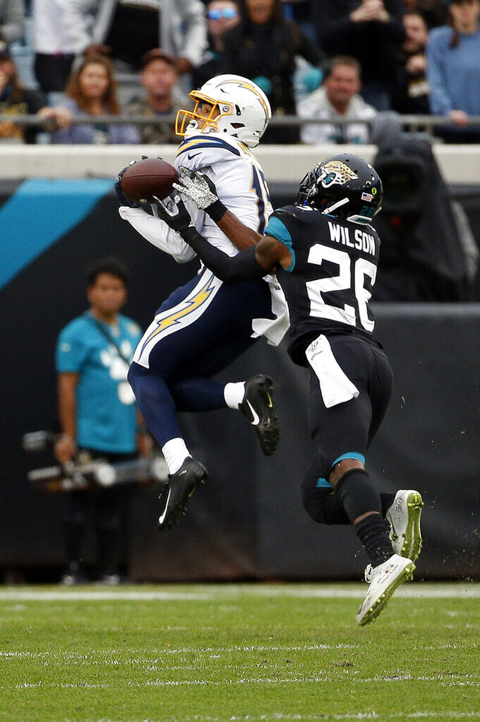 Jacksonville Jaguars free safety Jarrod Wilson (26) breaks up a pass intended for Los Angeles Chargers receiver Jayton Guton, left, during the first half of an NFL football game, Sunday, Dec. 8, 2019, in Jacksonville, Fla. (AP Photo/Stephen B. Morton)