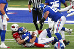 New York Giants quarterback Daniel Jones, bottom center, is sacked during the second half of an NFL football game against the Arizona Cardinals, Sunday, Dec. 13, 2020, in East Rutherford, N.J. (AP Photo/Noah K. Murray)