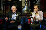 Former President Jimmy Carter and his wife former first lady Rosalynn Carter sit together during a reception to celebrate their 75th wedding anniversary Saturday, July 10, 2021, in Plains, Ga.. (AP Photo/John Bazemore, Pool)