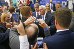 U.S. Vice President Mike Pence greets people after speaking at medical-device manufacturer Merit Medical Thursday, Aug. 22, 2019, in South Jordan, Utah. Pence is visiting Utah on a trip to promote the Trump administration's trade deal with Mexico and Canada. (AP Photo/Rick Bowmer)