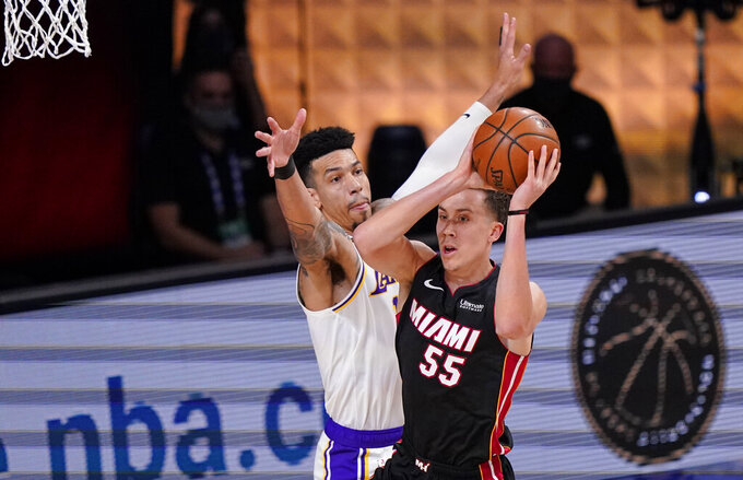 Miami Heat's Duncan Robinson (55) passes the ball against Los Angeles Lakers' Danny Green (14) during the first half in Game 3 of basketball's NBA Finals, Sunday, Oct. 4, 2020, in Lake Buena Vista, Fla. (AP Photo/Mark J. Terrill)