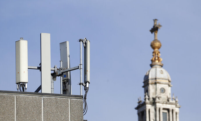 Mobile network phone masts are visible in front of St Paul's Cathedral in the City of London, Tuesday, Jan. 28, 2020.The Chinese tech firm Huawei has been designated a