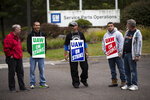 Members of the United Auto Workers continue to picket after news of a tentative contract agreement with General Motors, in Langhorne, Pa., Wednesday, Oct. 16, 2019. Bargainers for General Motors and the United Auto Workers reached a tentative contract deal on Wednesday that could end a monthlong strike that brought the company's U.S. factories to a standstill. (AP Photo/Matt Rourke)