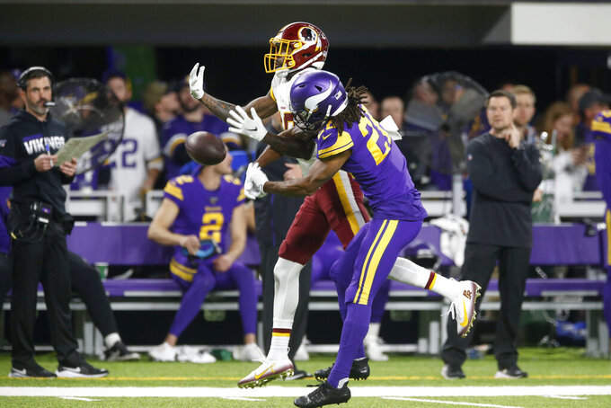 Minnesota Vikings cornerback Trae Waynes, right, breaks up a pass intended for Washington Redskins wide receiver Paul Richardson, rear, during the first half of an NFL football game, Thursday, Oct. 24, 2019, in Minneapolis. (AP Photo/Jim Mone)