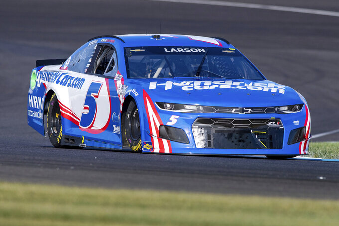 Kyle Larson (5) during qualifying for a NASCAR Cup Series auto race at Indianapolis Motor Speedway, Sunday, Aug. 15, 2021, in Indianapolis. (AP Photo/Doug McSchooler)