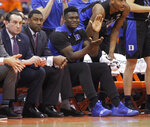 Duke's Zion Williamson, center, cheers after a basket from the bench during the second half of an NCAA college basketball game against Syracuse in Syracuse, N.Y., Saturday, Feb. 23, 2019. Duke won 75-65. (AP Photo/Nick Lisi)
