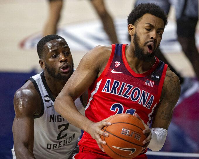 Oregon forward Eugene Omoruyi (2) guards Arizona forward Jordan Brown (21) in the corner of the court during an NCAA college basketball game, Saturday, Feb. 13, 2021, in Tucson, Ariz. (Josh Galemore/Arizona Daily Star via AP)