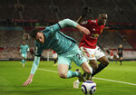Liverpool's Andrew Robertson, left, duels for the ball with Manchester United's Aaron Wan-Bissaka during the English Premier League soccer match between Manchester United and Liverpool, at the Old Trafford stadium in Manchester, England, Thursday, May 13, 2021. (AP Photo/Dave Thompson,Pool)