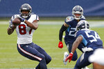 Houston Texans tight end Darren Fells (87) catches a pass as Tennessee Titans inside linebacker Rashaan Evans (54) closes in during the first half of an NFL football game Sunday, Oct. 18, 2020, in Nashville, Tenn. (AP Photo/Wade Payne)