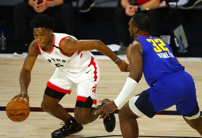 Toronto Raptors' Stanley Johnson (5) drives against Denver Nuggets' Noah Vonleh (32) during the fourth quarter of an NBA basketball game Friday, Aug. 14, 2020, in Lake Buena Vista, Fla. (Mike Ehrmann/Pool Photo via AP)