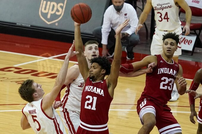 Wisconsin's Tyler Wahl is fouled as he shoots during the second half of an NCAA college basketball game against Indiana Thursday, Jan. 7, 2021, in Madison, Wis. (AP Photo/Morry Gash)