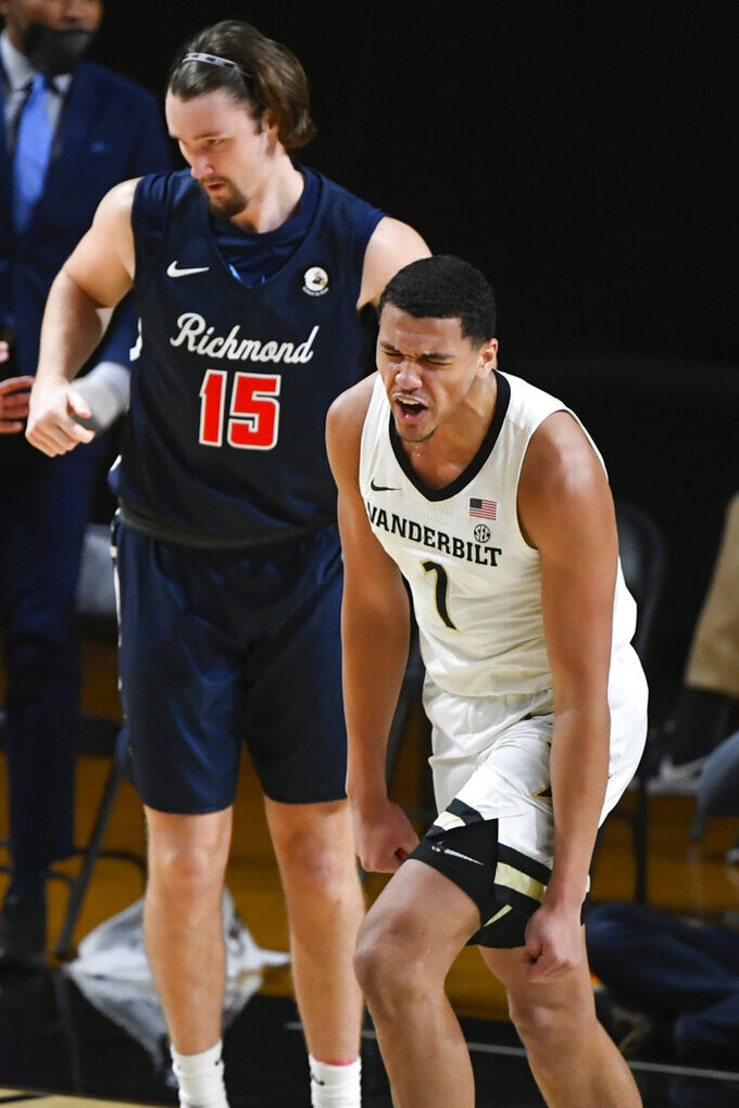 Vanderbilt forward Dylan Disu (1) reacts after scoring on Richmond forward Matt Grace (15) during the second half of an NCAA college basketball game Wednesday, Dec. 16, 2020, in Nashville. Richmond won 78-67. (AP Photo/John Amis)