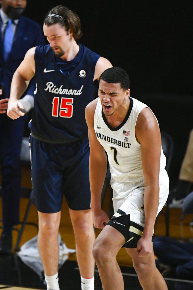 Vanderbilt forward Dylan Disu (1) reacts after scoring on Richmond forward Matt Grace (15) during the second half of an NCAA college basketball game Wednesday, Dec. 16, 2020, in Nashville. Richmond won 78-67. (AP Photo/John Amis)