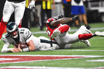 Philadelphia Eagles quarterback Carson Wentz (11) hits the turf near the goal line working for a two-point conversion against the Atlanta Falcons during the second half of an NFL football game, Sunday, Sept. 15, 2019, in Atlanta. The conversion was missed. (AP Photo/John Amis)