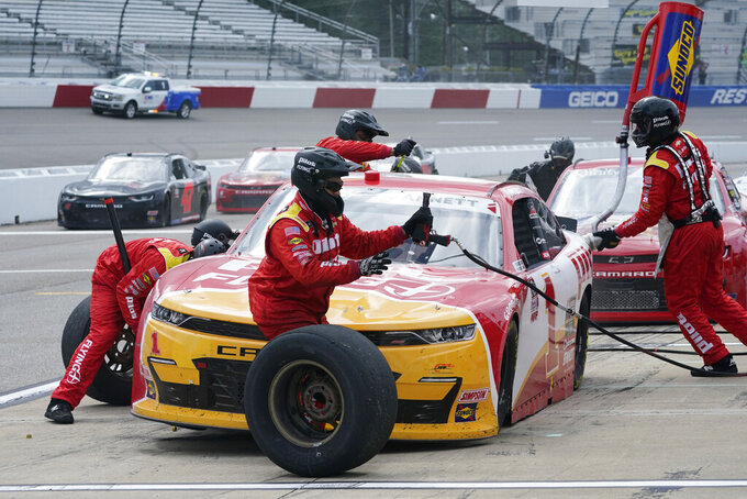 CORRECTS DATE TO SEPT. 12-Michael Annett (1) gets service in the pits during a NASCAR Xfinity Series auto race Saturday, Sept. 12, 2020, in Richmond, Va. (AP Photo/Steve Helber)
