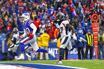 Buffalo Bills wide receiver Cole Beasley (10) crosses the goal line to score a touchdown ahead of Denver Broncos cornerback Davontae Harris during the third quarter of an NFL football game, Sunday, Nov. 24, 2019, in Orchard Park, N.Y. (AP Photo/Adrian Kraus)