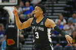 San Antonio Spurs guard Keldon Johnson (3) runs up court after scoring against the Memphis Grizzlies during the first half of an NBA Summer League basketball game Tuesday, July 2, 2019, in Salt Lake City. (AP Photo/Rick Bowmer)