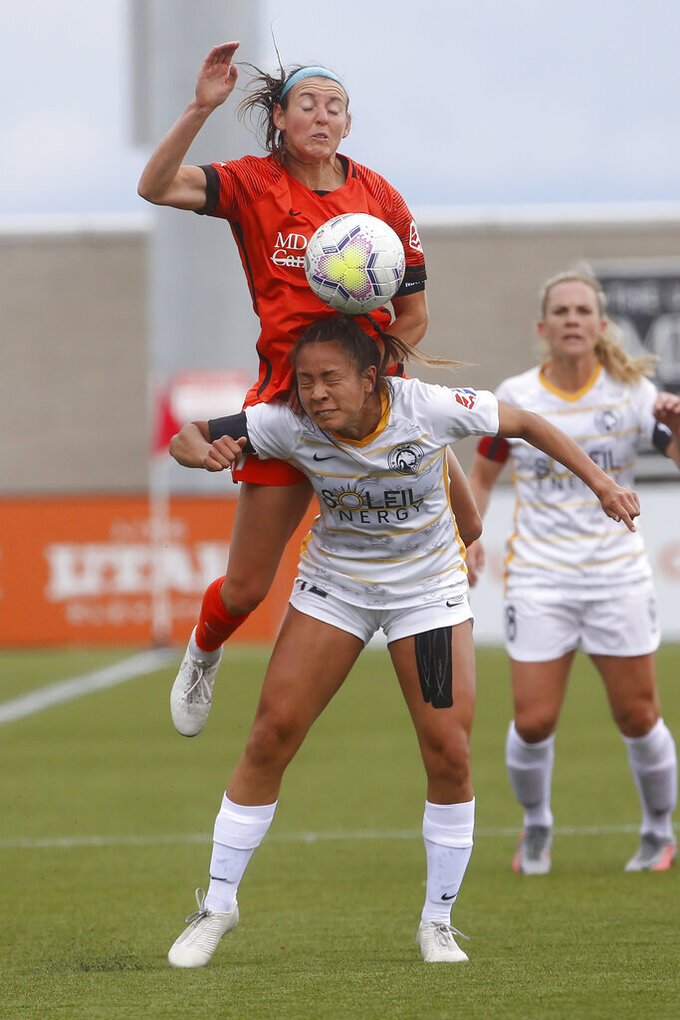Houston Dash midfielder Erin Simon, rear, and Utah Royals FC forward Raissa Strom-Okimoto battle for the ball during the first half of an NWSL Challenge Cup soccer match at Zions Bank Stadium Tuesday, June 30, 2020, in Herriman, Utah. (AP Photo/Rick Bowmer)