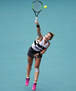 Simona Halep, of Romania, serves to Polona Hercog, of Slovenia, during the Miami Open tennis tournament, Sunday, March 24, 2019, in Miami Gardens, Fla. (AP Photo/Lynne Sladky)