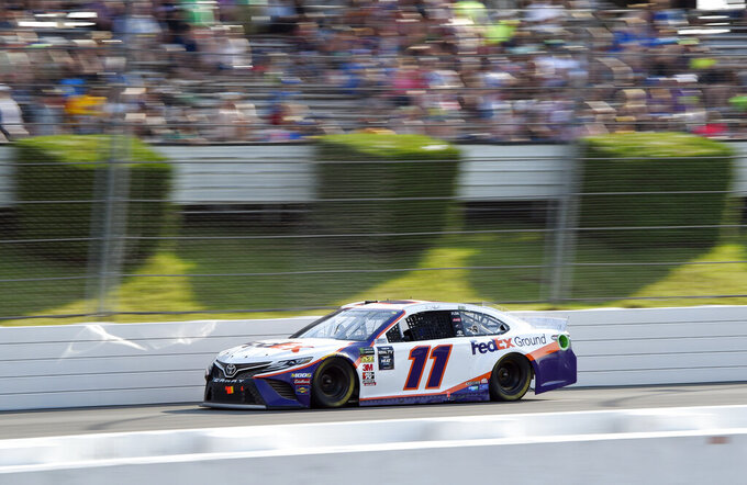 Denny Hamlin drives down the front stretch during a NASCAR Cup Series auto race, Sunday, July 28, 2019, in Long Pond, Pa. Hamlin won the race. (AP Photo/Derik Hamilton)