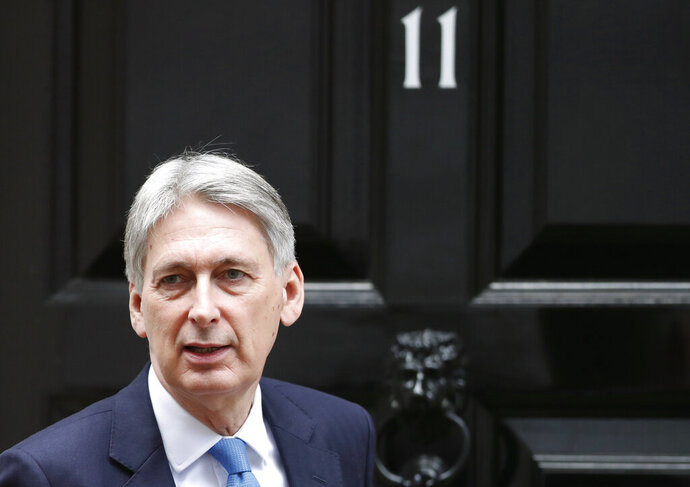 "FILE - In this Wednesday, Jan 9, 2019 file photo, Britain's Chancellor of the Exchequer Philip Hammond leaves 11 Downing Street for the House of Commons to attend Prime Minister's question time, in London. Hammond says he will quit if, as widely expected Boris Johnson becomes prime minister. Hammond said Sunday, July 21, 2109 that Johnson's vow to take the U.K. out of the European Union on Oct. 31, with or without a divorce deal is ""not something that I could ever sign up to."" (AP Photo/Alastair Grant, File)"