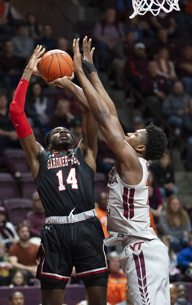 Gardner-Webb forward Kareem Reid (14) shoots the ball against Virginia Tech forward John Ojiako (21) during the first half of an NCAA college basketball game Sunday, Dec. 15, 2019 in Blacksburg, Va. (Don Petersen/Roanoke Times via AP)
