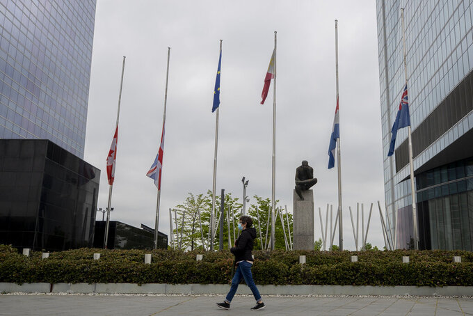 The British flag, second left, is set among others at half mast outside the British embassy in Madrid, Spain, Friday, April 9, 2021. Prince Philip, the irascible and tough-minded husband of Queen Elizabeth II who spent more than seven decades supporting his wife in a role that both defined and constricted his life, has died, Buckingham Palace said Friday. He was 99. (AP Photo/Manu Fernandez)