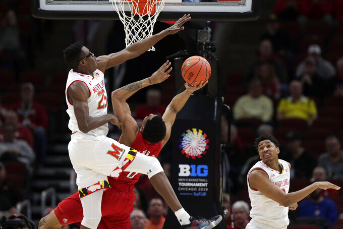 Maryland's Jalen Smith (25) blocks a shot by Nebraska's James Palmer Jr. (0) during the first half of an NCAA college basketball game in the second round of the Big Ten Conference tournament, Thursday, March 14, 2019, in Chicago. (AP Photo/Kiichiro Sato)