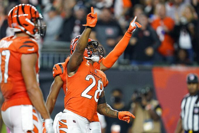 Cincinnati Bengals' Joe Mixon (28) celebrates a touchdown run during the second half of an NFL football game against the Jacksonville Jaguars, Thursday, Sept. 30, 2021, in Cincinnati. (AP Photo/Michael Conroy)