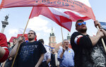Critics of the European Union march through Warsaw to protest against, what they call EU's dictate from Brussels, as Poland and other central European nations ceremoniously mark 15 years of membership in the club, in Warsaw, Poland, Wednesday, May 1, 2019. (AP Photo/Czarek Sokolowski)