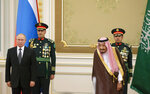 Russian President Vladimir Putin, left, and Saudi Arabia's King Salman, second from right, attend the official welcome ceremony in Riyadh, Saudi Arabia, Monday, Oct. 14, 2019. (AP Photo/Alexander Zemlianichenko, Pool)