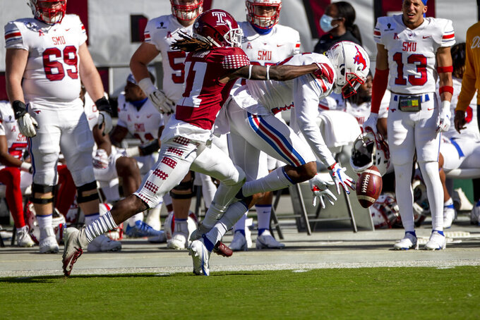 Temple cornerback Linwood Crump (11) breaks up a pass intended for SMU wide receiver Danny Gray (5) in the first half of an NCAA college football game, Saturday, Nov. 7, 2020, in Philadelphia. (AP Photo/Laurence Kesterson)