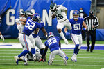Philadelphia Eagles' Miles Sanders (26) leaps over New York Giants' Logan Ryan (23) during the second half of an NFL football game Sunday, Nov. 15, 2020, in East Rutherford, N.J. (AP Photo/Seth Wenig)