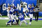 Philadelphia Eagles' Miles Sanders (26) leaps over New York Giants' Logan Ryan (23) during the second half of an NFL football game Sunday, Nov. 15, 2020, in East Rutherford, N.J. (AP Photo/Seth Wenig)