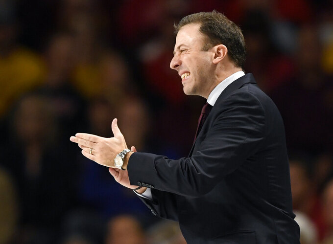 Minnesota coach Richard Pitino watches his team play Wisconsin during the first half of an NCAA college basketball game Wednesday, Feb. 5, 2020, in Minneapolis. (AP Photo/Hannah Foslien)