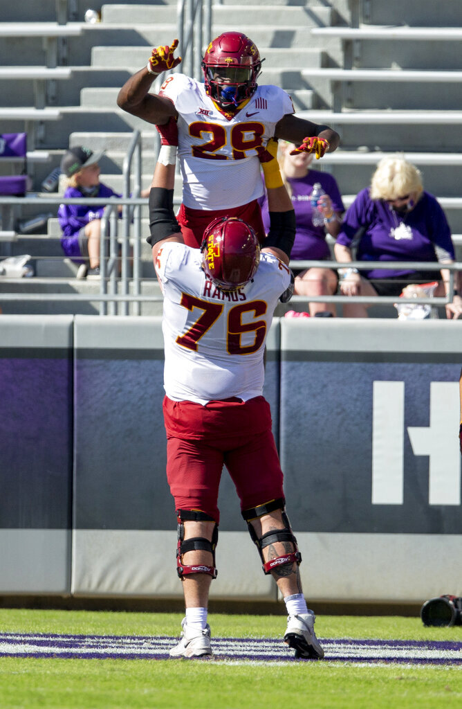 Iowa State running back Breece Hall (28) is lifted into the air by offensive lineman Joey Ramos (76) after scoring a touchdown during an NCAA college football game against TCU on Saturday, Sept. 26, 2020 in Fort Worth, Texas. Iowa won 37-34. (AP Photo/Brandon Wade)