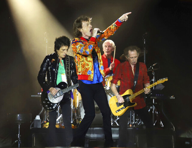 FILE - In this Aug. 5, 2019 file photo, Ronnie Wood, from left, Mick Jagger, Charlie Watts and Keith Richards of The Rolling Stones perform  in East Rutherford, N.J. The Rolling Stones are postponing its 15-city North American tour because of the coronavirus. The band announced Tuesday that it's No Filter Tour, originally expected to kick off in San Diego on May 8, will no longer take place. (Photo by Greg Allen/Invision/AP, File)