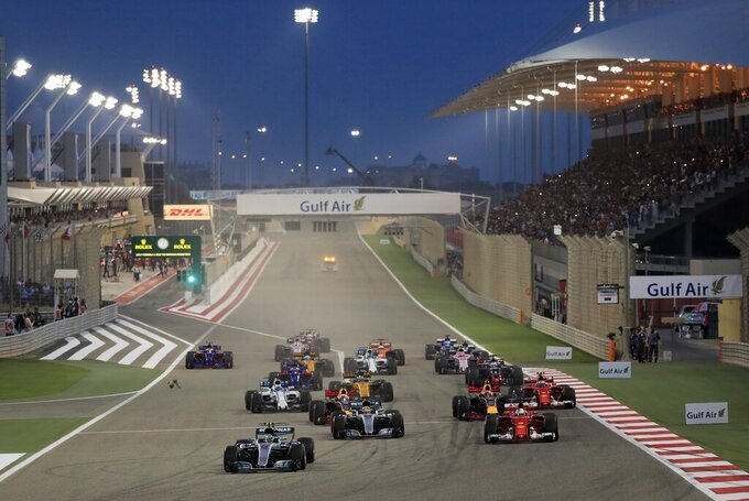 FILE - In this Sunday, April 16, 2017 file photo, Mercedes driver Valtteri Bottas of Finland, foreground left, leads at the start of the Bahrain Formula One Grand Prix, at the Formula One Bahrain International Circuit in Sakhir, Bahrain.  Saudi Arabia says it will host a Formula One race starting next year.  The kingdom says on Thursday, Nov. 5, 2020,  it will host the race in November 2021 in the Red Sea city of Jiddah.  (AP Photo/Hassan Ammar, File)