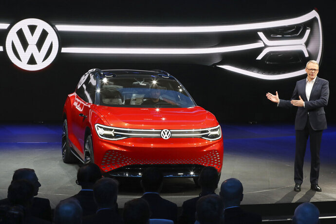 FILE - In this Tuesday, April 16, 2019, file photo, Volkswagen unveils a concept electric SUV, the whimsically named ID. ROOMZZ during the Auto Shanghai 2019 show in Shanghai. Volkswagen says Friday, May 29, 2020, it will spend 2 billion euros ($2.2 billion) to expand its presence in China's electric car industry in the biggest foreign investment announced since the country shut down to fight the coronavirus. (AP Photo/Ng Han Guan, File)