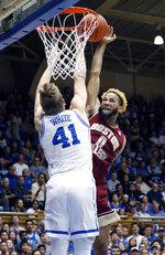 Duke's Jack White (41) blocks a shot by Boston College's Ky Bowman (0) during the first half of an NCAA college basketball game in Durham, N.C., Tuesday, Feb. 5, 2019. (AP Photo/Chris Seward)
