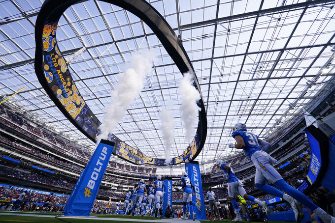 The Los Angeles Chargers enter the field before a preseason NFL football game against the San Francisco 49ers Sunday, Aug. 22, 2021, in Inglewood, Calif. (AP Photo/Ashley Landis)