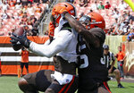 Cleveland Browns tight end David Njoku, left, hauls in a touchdown catch while defended by safety Jovante Moffatt on an 11-on-11 drill during an Orange and Brown NFL football practice in Cleveland, Sunday, Aug. 8, 2021. (John Kuntz/The Plain Dealer via AP)